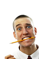 Businessman with a pencil in his mouth