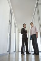 Businesswoman and businessman in corridor