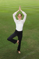 Businesswoman practising yoga