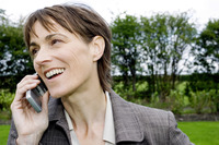 Businesswoman smiling while talking on the mobile phone