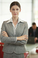 Businesswoman standing arms crossed portrait