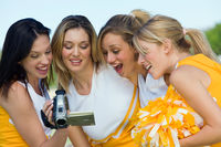 Popular : Cheerleaders watching video on video camera