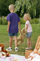 Children bringing a toy bear for walk