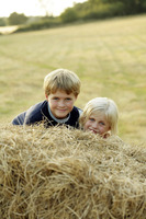 Children emerging from a haystack