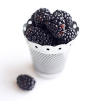 Popular : Close up of some blackberries in a container