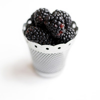 Close up of some blackberries in a container