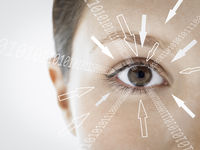 Close-up portrait of businesswoman with binary digits and arrow signs moving towards her eye against white background