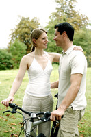 Couple and a bicycle in the park