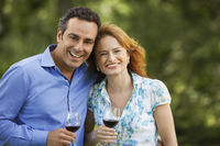 Couple drinking wine in back yard portrait