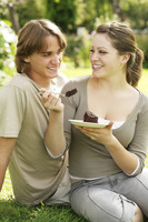 Couple indulging in a piece of chocolate cake