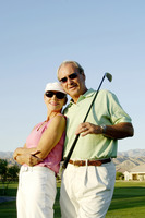Popular : Couple posing in the golf course