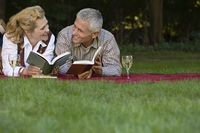 Couple relaxing with books and wine