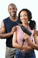 Couple with power drill portrait