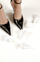 Popular : Crumpled papers beside woman s feet