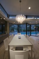 Dining table of palm springs home lit with glass chandelier