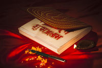 Diwali diya and a pen with ledger book during diwali festival
