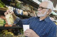 Elderly man vegetable shopping
