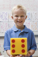 Elementary student with large die