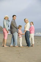 Family standing on beach portrait