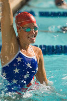 Female swimmer celebrating victory in pool