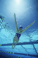 Female swimmer wearing united states swimsuit swimming in pool