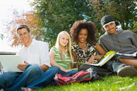 Four students studying outdoors  portrait
