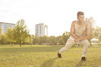 Popular : Full length of confident young man exercising in park