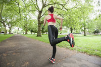 Full length rear view of fit woman jogging in park