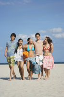 Popular : Group of teenagers  16-17  walking on beach portrait