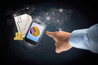 Hand pointing towards mobile phone with documents and coins