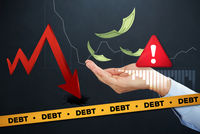 Hand with financial debt concept