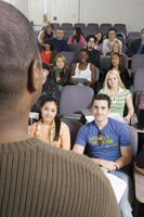 Lecturer teaching university students in lecture hall