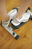 Legs stepping on exercise equipment
