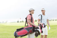 Popular : Male golfers communicating at golf course against clear sky
