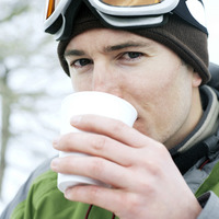 Man in warm clothing enjoying a cup of hot drink