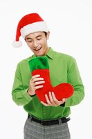 Man looking into christmas stocking