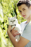Man posing with a white cat