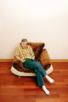 Popular : Man sitting on the couch reading book