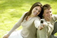 Mother and son taking picture with camera phone
