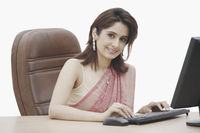 Portrait of a businesswoman working on a computer