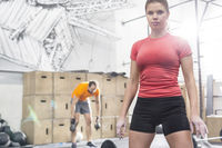 Popular : Portrait of confident woman standing in crossfit gym