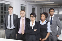 Portrait of confident young multiethnic business group at office