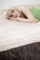 Popular : Portrait of teenage girl  16-17  lying on bed