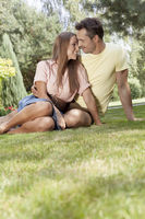 Romantic young couple relaxing in park