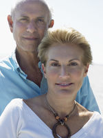 Senior couple on tropical beach close up
