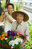 Senior man and son gardening  portrait