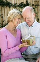 Senior woman getting a present from her husband
