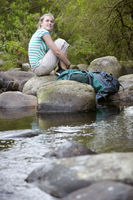 Popular : Teenage girl  16-17 years  sitting on stone by river looking up