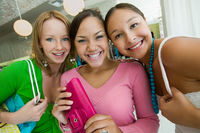 Popular : Three girls shopping at boutique portrait
