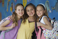 Popular : Three school girls outside school portrait